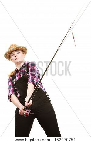 Spinning equipment angling cheerful fisherwoman concept. Focused woman in sun hat holding fishing rod hunting and fighting with fish on hook