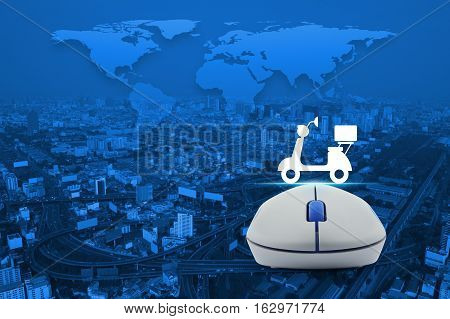 Wireless computer mouse with motor bike icon over city tower street and expressway Business internet delivery service concept Elements of this image furnished by NASA