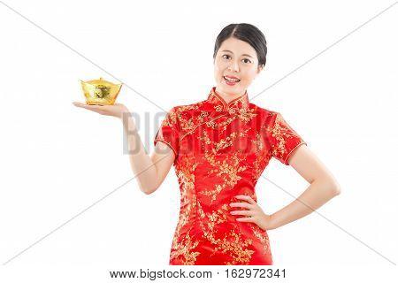 Happy Woman Presenting Golden Ingot