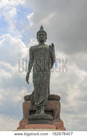 Big Buddha statue ancient on blue sky background in Nakhon Pathom Province of Thailand