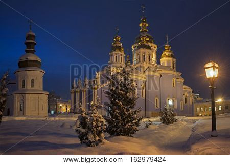 Snow powdered Saint Michael's Golden-Domed Cathedral and John the Apostle church. Evening view.