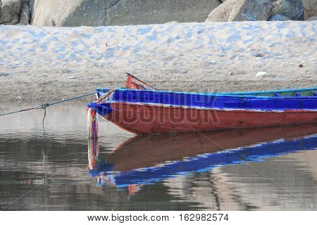 Wooden fishing boat ancient in river :Select focus with shallow depth of field.