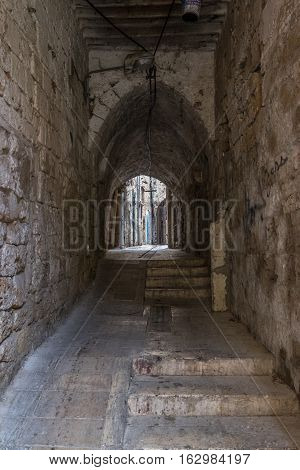 A small street in Akko, Acers with stone walls and steps