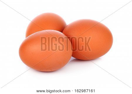 three eggs isolated on white background bird, brown, easter, albumen, organic, chicken