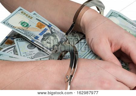 hands tied for a bribe handcuffs on dollars background