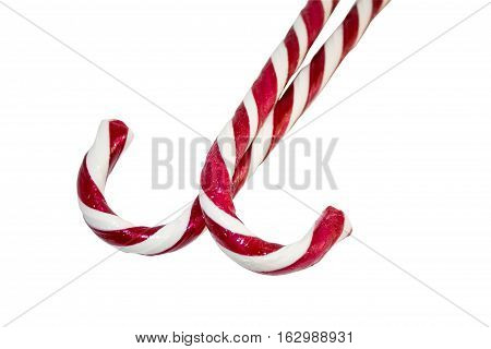 A candy cane or peppermint stick is a cane-shaped stick candy often associated with Christmastide as well as Saint Nicholas Day.