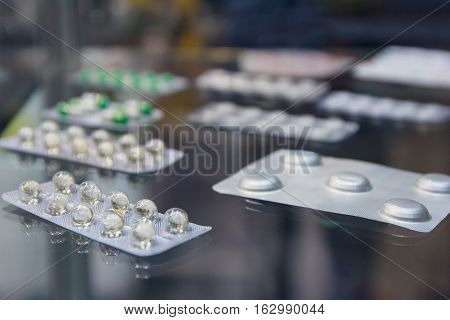 Pharmaceutical medicine pills on the table. Industry