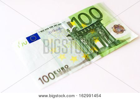 Euro banknotes are in denominations of 100 euros. Symbol of European currency to wealth and investment. Money of European Union. Selective focus blurred background with bokeh
