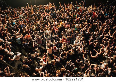 BUDAPEST, HUNGARY - NOVEMBER 29TH: A BIRDS-EYE VIEW OF A CROWD ON A CONCERT DURING PERFORMANCE OF PARKWAY DRIVE BAND AT PECSA MUSIC HALL 2012, IN BUDAPEST, HUNGARY