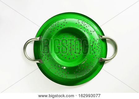 a Old green metal the colander sieve
