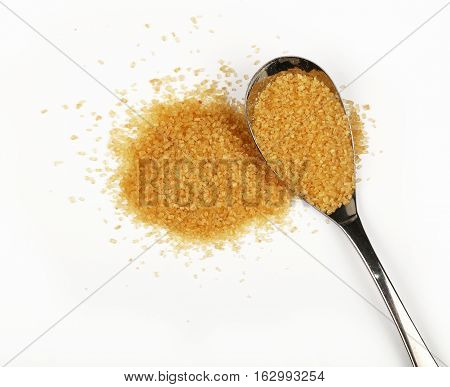 Spoon And Pinch Of Brown Cane Sugar On White