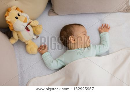 Baby Sleeping on the bed. Adorable baby sleeping at night. Little girl in pajama taking a nap