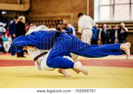 judoka wrestlers athletes winning throw ippon in judo competitions