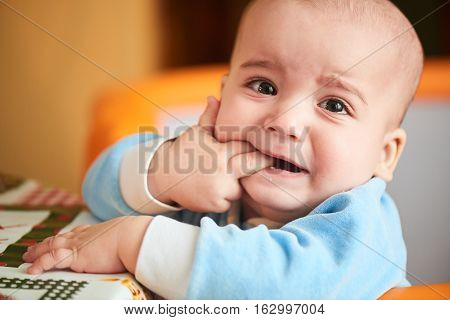 The boy was crying and biting your fingers