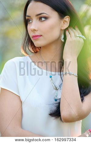 european fashion model with luxury accessory. Close-up beauty portrait with jewelry