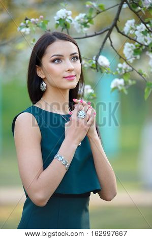 Beautiful young fashion model with with long hair wearing jewelry luxury jewelry and accessory. Spring collection. Beauty fashion portrait
