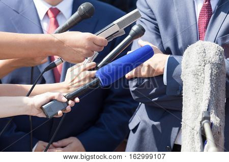 Media interview with businessperson or politician. Press conference.
