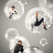 Sad businessmen flies in a bubbles. isolate themselves inside a bubbles detachment from the outside world concept poster