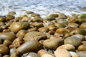 The rocky beach at Porth Nanven Cornwall UK. poster