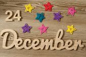 Christmas Eve Date On Calendar. December 24. Wooden Background. 24th day of calendar last month of the year. poster