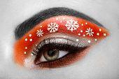 Eye girl makeover snowflakes. Winter christmas makeup. Beauty fashion. Eyelashes. Cosmetic Eyeshadow. Makeup detail. Creative woman holiday make-up poster
