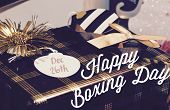 Happy Boxing Day December 26th retro gift box with tag that says Dec 26th and words written for Canadian Holiday of returning gifts or buying Christmas gifts on promotions and sale poster