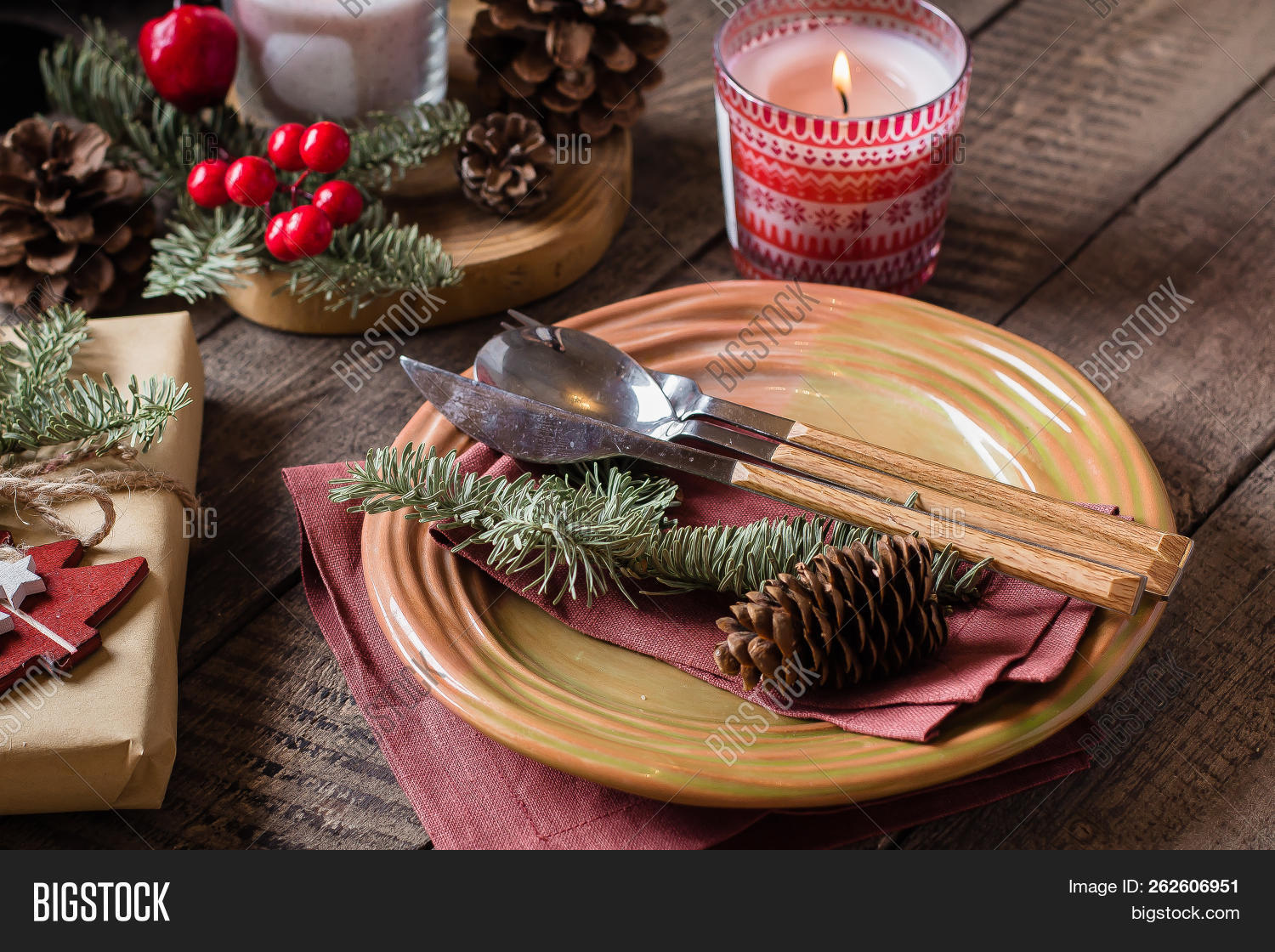 Christmas Setting Table. Dinner plate, silverware, fir tree, gift boxe, candle and festive decoration. Holiday Food Concept. Top view