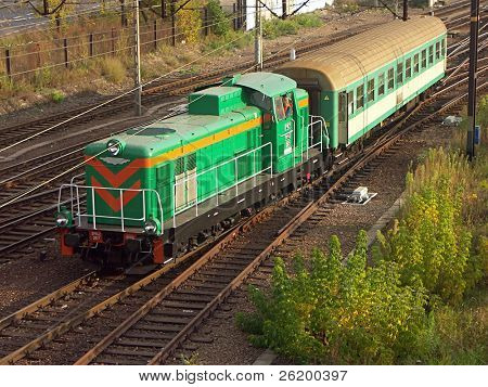 Switching diesel locomotive hauling railway car 1027_10