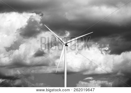 Lonely Wind Turbine. Stormy Sky Background. Black And Whitephotography