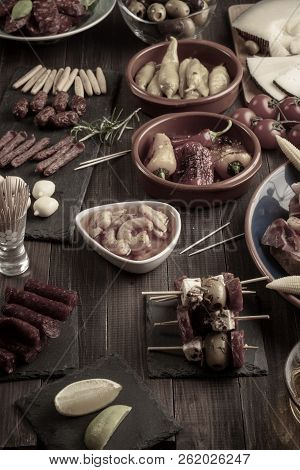 Mixed Appetizers On Wooden Table. Spanish Tapas For New Years Eve. Vintage Effect