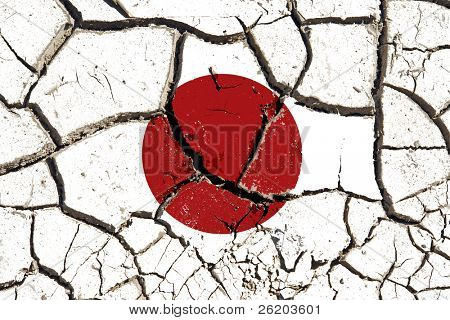 Cracked soil as Japan flag to symbolize the recent earthquake and calamity that struck this country