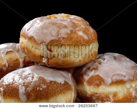 Polish donuts with icing over black background