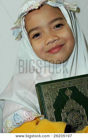Little Muslim girl with Al-Quran