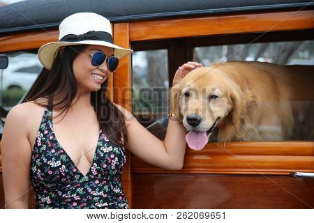Girl with her dog. A beautiful woman with classic car and  beautiful dog. classic car. beautiful woman. beautiful dog.