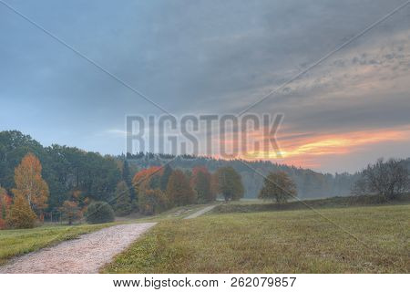 Latvia Country Side Landscape With Fog And Mist After Sunset