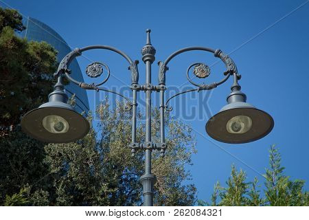 An Image Of Street Light On Blue Sky . Vintage Lamppost . Modern Street Lamp Shines Against A Backgr