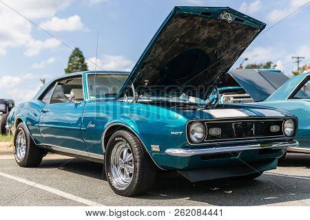 Matthews, North Carolina-  September 3, 2018: A Classic 1960s Era Chevrolet Camaro Is Parked On Disp