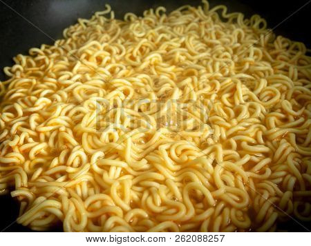 Boiling Cooking Instant Noodles Or Dry Noodles In Pan.