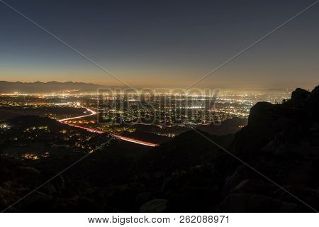 Los Angeles California mountain peak dawn view of Porter Ranch and the 118 freeway in the San Fernando Valley.