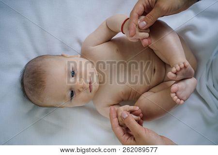 Happy Little Baby Enjoy Doing Gymnastics. Little Baby Enjoy Motor Activity. Happy Newborn At Home. D