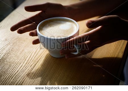 Barista Propose Americano Or Espresso Coffee Cup. Fresh Morning Coffee With Milk And Cream Froth. Go