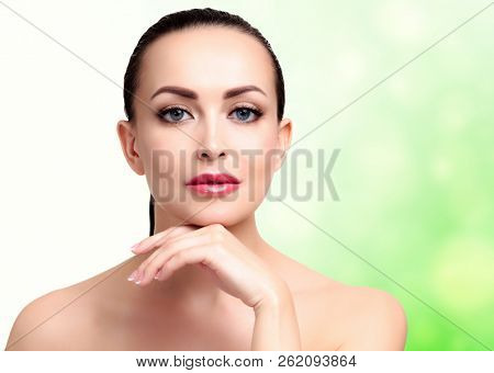 Pretty woman with clean and fresh skin. Beautiful girl portrait. Skin care concept