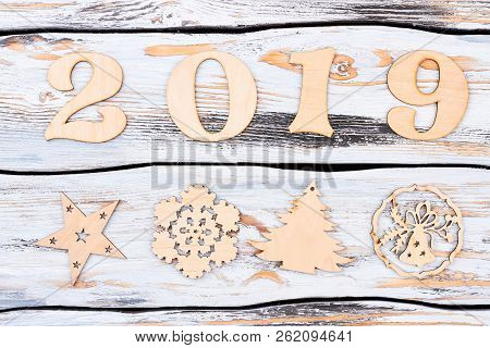 Wooden Number 2019 And New Year Figures. New Year Number 2019 From The Wooden Digits And Carved Wood