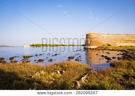Old Fortress Guarding The Sheltered Cove, The Adriatic Sea, Croatia