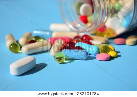 Medicines Banned, Pills Recall. Multicolored Bright Various Type Pills And Capsules Spilling Out Of