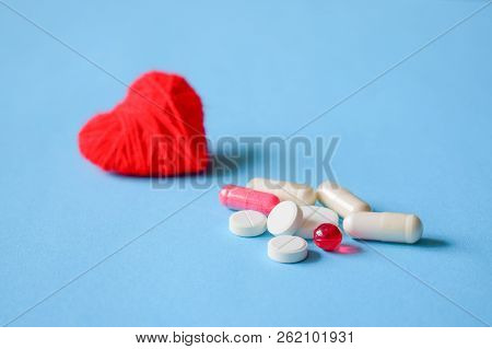 Blood Pressure Pills. White And Red Various Pills And Capsules With Red Heart On Blue Background. Co