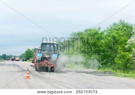 Kropivnitskiy, Ukraine – 27 May, 2018: Road Repair Concept. Road Construction Equipment And Workers