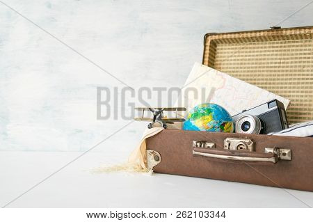 Travel, Adventure, Vacation Concept. Brown Retro Suitcase With Traveler Set Of Travel Booklets, Maps