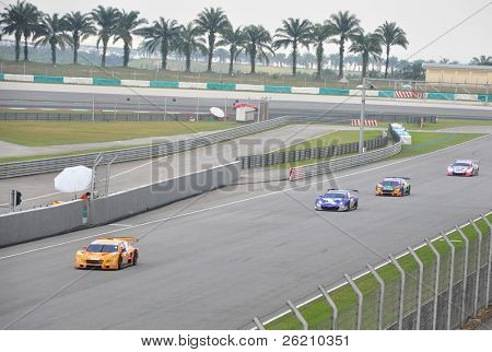 SEPANG, MALAYSIA - JUNE 20 : SuperGT drivers in battle for position during the Super GT International Series, Round 4 on June 20, 2010 in Sepang International Circuit, Malaysia.