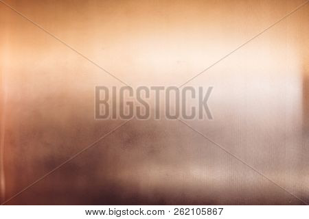 Art Deco Style Shiny Glossy Copper Clad Wall With Light Reflection. Texture Backround